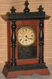 "Antique Mantle Clock with black trim and finials, Key Wound Eagle on back panel. No other identifying marks.  (18.5""H x 11""W x 5""D)"