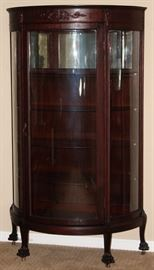 Antique Mahogany Bow Front China Cabinet with 4 Adjustable Shelves raised on Claw Feet with Original Casters