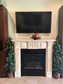 Jensen Portable Fireplace and Samsung TV