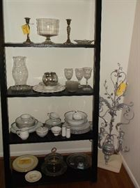 More glassware and Mikasa china on ladder bookshelf and five arm wall hanging candelabrum