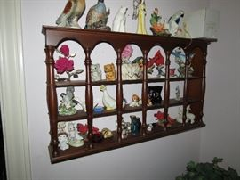 Curio Shelf Full Of Collectible Figurines