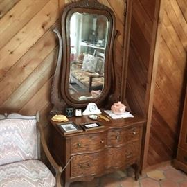 Oak Princess Dresser with attached mirror features 4 shaped legs on casters.