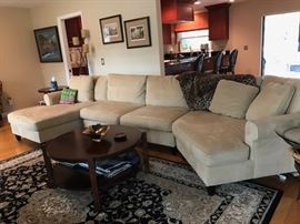 Sofa, coffee and lamp tables along with the area rug