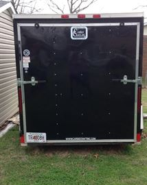 Rear view of the Cargo Craft Trailer. Size deminsions are 6' wide x 12' long x 6' high and features an overhead ventilation.