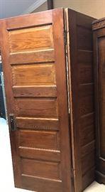 hinged pair of old pine doors