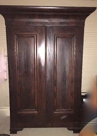 tall and handsome Empire flame mahogany armoire