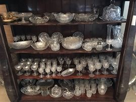 large set of cut glass tableware and serving pieces