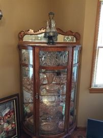 Oak vintage curio cabinet with beveled lead glass front