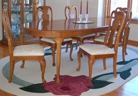 Oak Dining Table and Area Rug