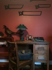 Collection of vintage saws, oak desk & chair, taxidermy pheasant, typewriter, toleware lamp