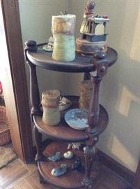 small circular display stand, candles, knickknacks etc