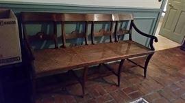 Cane bottom bench/ settee w/ inlaid design