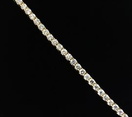 Tennis Bracelet with 34 diamonds equaling 14.59 carat total weight. Mounted in 18 karat yellow gold. I, J color. SI clarity. $16,500.