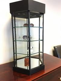 Counter top display case with led lights. Sleek, six sided matte black case with mirrored floor and lock.  $250.