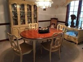 French Provincial dining room suite.  Table has 2 leaves and 6 chairs