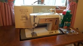 Singer Model 603 Sewing Machine with Sewing Cabinet/Table and Accessories