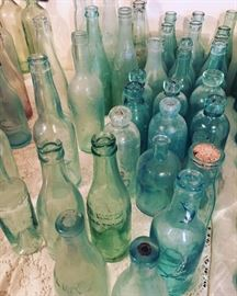 antique bottles and glass from the early 1900s