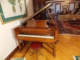 "Fischer player baby grand piano, 9 legged, 5'4"" and twisted wrought iron base piano stool."