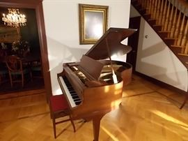 "Wurlitzer baby grand piano ""John W. Myers"", 4'11"" and red seat orchestra bench w/storage"