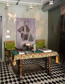 two green velvet upholstered chairs and wooden settee table