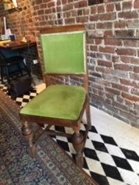 one of six green velvet upholstered chair