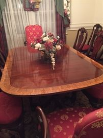 Gorgeous inlaid wood dining set.  Includes 12 chairs