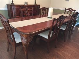 Beautiful Broyhill cherry dining room furniture from Haverty's--table, 6 chairs and buffet, all in excellent condition. With leaves, table extends to 9'.