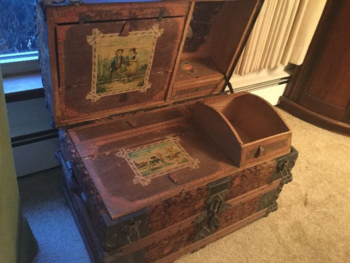 Trunk with hat, shoe, and glove compartment.