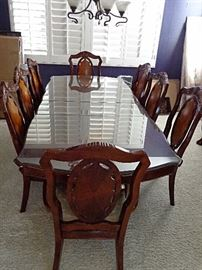AICO Dining table and 8 chairs