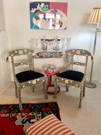 Accent furnishings; mirrored console table; Inlaid rams head side chairs; Painted metal stool; Crystal barware; Modern art by Daphne Spencer