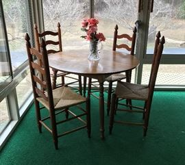 Kitchen Table with 4 cane bottom chairs