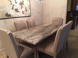 marble dining table with 6 upholstered chairs