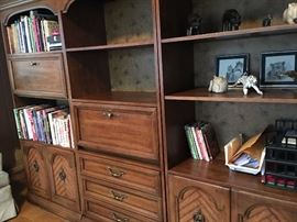 walnut wood entertainment center with drawers, cabinets and shelves