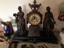 metal figural mantle clock