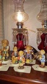 Selection of Hummel figurines along with a very nice matched pair of prism lamps
