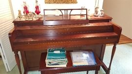 Lester brand piano and bench - serial number dates to 1958.  Very beautiful mahogany.