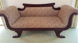 Fabulous circa late 1800's upholstered mahogany sofa.  Federal style with beautifully detailed wood.