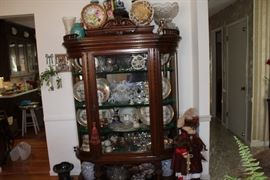 Antiques hutch loaded with glassware