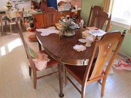 Oak Dining table w/high back cane chairs