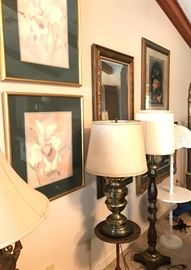 Framed pictures, beveled mirror, table and floor lamps, accent table.