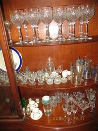 Assorted crystal stemware, salts, etched footed glasses and lots more