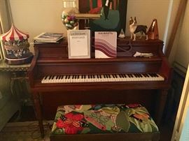 Fisher upright Piano, made by Aeolian with bench not pictured.