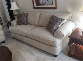 This GORGEOUS new set includes sofa, loveseat and chair! It literally has the tags on it! It was purchased to stage this home!