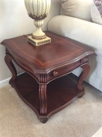 We have a coffee table, sofa table, and coordinating end tables by American Signature!