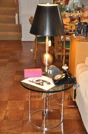 Chrome and heavy glass round side table (also shown with rare Andy Warhol domino set and Arabia walrus!)