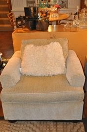 One of the two contemporary beige upholstered Expressions chair!