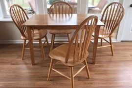 Dining or game table with four matching chairs