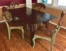 This black-walnut table with custom-designed legs was hand-crafted by homeowner; four Pier One chairs adorn it here, but it could be a stunning addition to any room