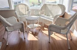 Hampton Bay all-weather white wicker settee, three arm chairs, and side table in brand-new condition (this set has not been exposed to weather)