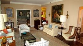 Livingroom- Owner chose to keep the loveseat on left and two striped chairs